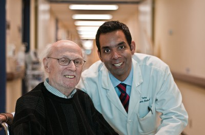 Dr. Samir Sinha with a patient