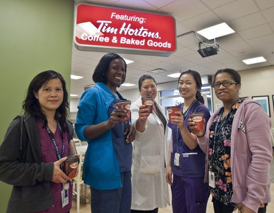 Staff with free Tim Hortons coffees