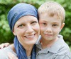 Mother recovering from breast cancer with child