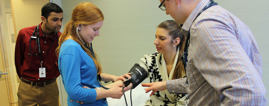 Medical student checks blood pressure